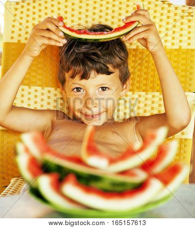 cute young little boy with watermelon crustes smiling, well done