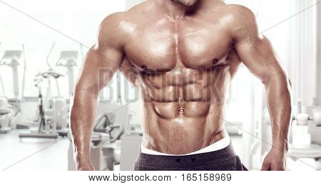 Muscular Bodybuilder Guy Standing On Gym