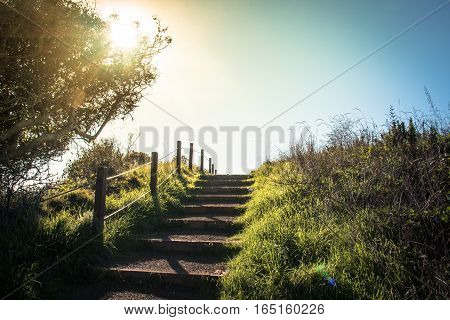 Lonely footpath leading up the stairs in the sunset