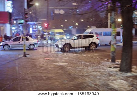 Blurred background. Blurred car on city street. winter night