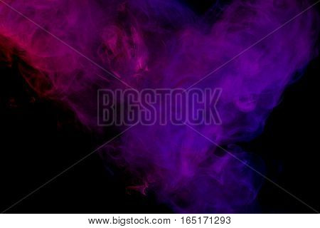 Abstract smoke Weipa. Personal vaporizers fragrant steam. The concept of alternative non-nicotine smoking. Purple pink smoke on a black background. E-cigarette. Evaporator. Taking Close-up. Vaping.