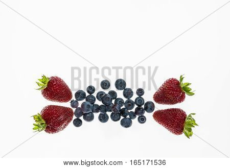 closeup of strawberries and blueberries isolated on white background