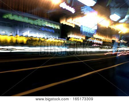 Blurred Lights And Building Of Big City In Night Time