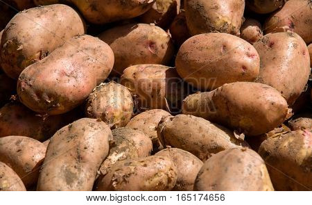 potatoes on the market as a background.