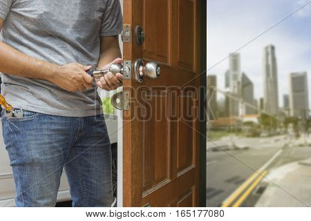 locksmith open the wood door to blur city and road - can use to display or montage on product