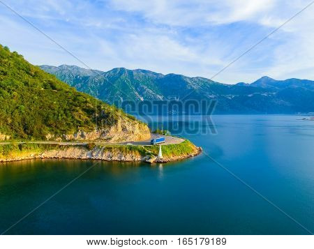 The road on coast of Boka Kotor bay - Montenegro - nature and architecture background