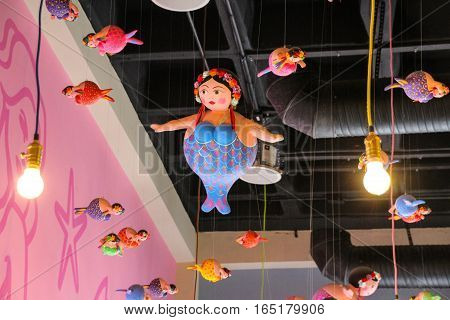 Fat Mermaids Hanging From The Roof