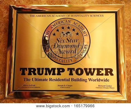 NEW YORK- DECEMBER 15, 2016:  A plaque awarding the Trump Tower six stars by the American Academy of Hospitality Sciences displayed in the Trump Tower in New York