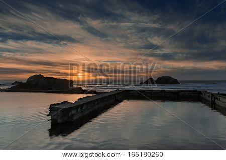 Sunset over Sutro Baths, San Francisco, California, USA