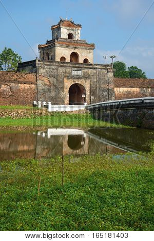 One of ancient gate with a bastion of a citadel of the city of Hue. Vietnam