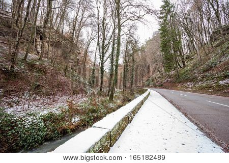 an snowy footpath along the road in the mountains