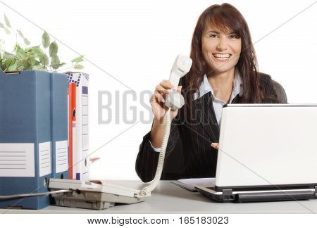 Businesswoman with telephone and smiling. Business concept