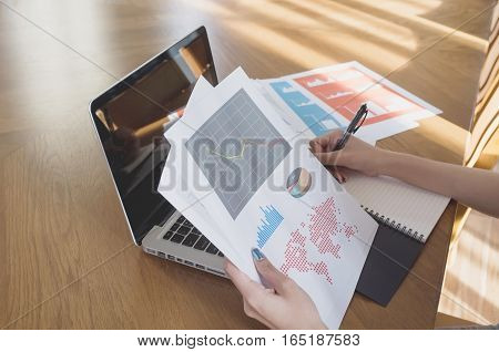 Young Woman Using Computer Laptop And Financial Document In Meeting Room.