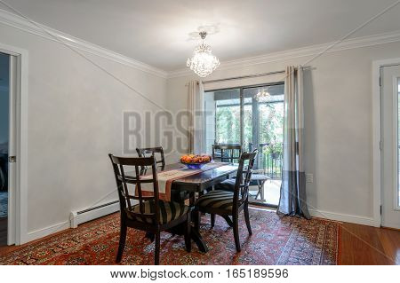 Spacious bright dining room with a dinner table. Interior design.
