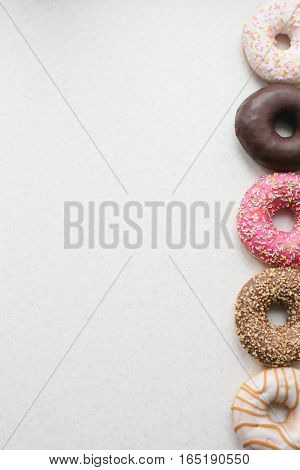 Colored Donuts On A Light Background