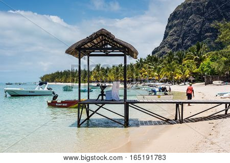 Le Morne Mauritius - December 7 2015: A setup for a romantic dinner on the Le Morne Beach one of the finest beaches in Mauritius and the site of many hotels and tourism facilities.