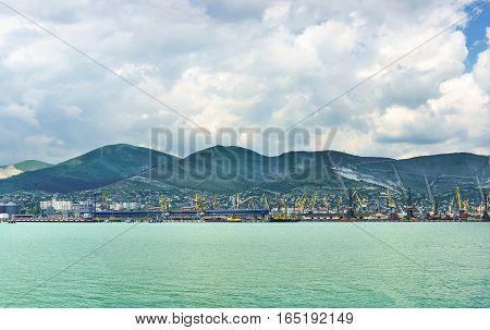 Panorama of Novorossiysk sea port on the background ridge mountains
