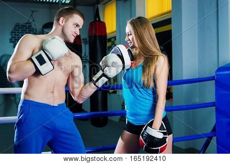 Male And Female Sporty Couple Practicing Boxing At The Gym At Boxing Ring.