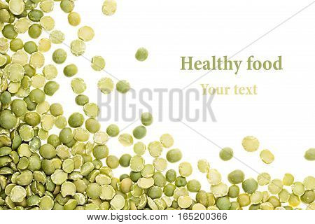Border of green dry purified peas closeup with copy space on white background. Isolated. Healthy protein food.