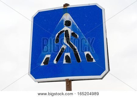 Grunge old road warning sign. Crosswalk on white background