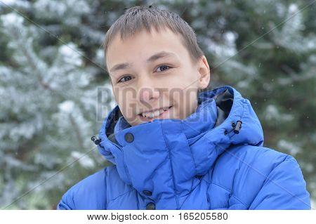 Portrait of a teen boy portrait outdoors in winter