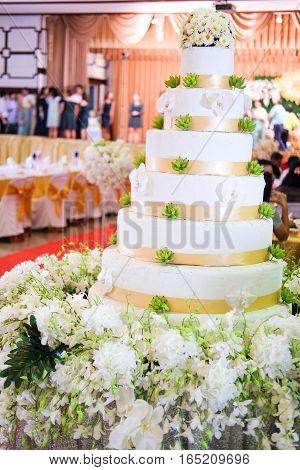 Wedding cake with flower decorate in wedding ceremony