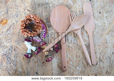 Dried flower garland in Thai style and wood kitchenware