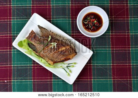 Deep Fried Little Tilapia Fish Served With Spicy Bean Sauce.