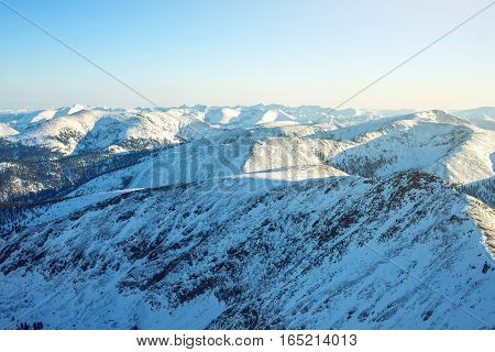Majestic Winter Landscape Of Snowy Mountains With Clear Blue Sky
