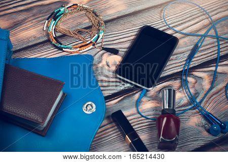 Lady purse stuff - smart phone, ear headphones, cosmetics, jewellery