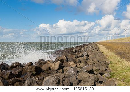 Waves near a Dutch breakwater with Windturbines