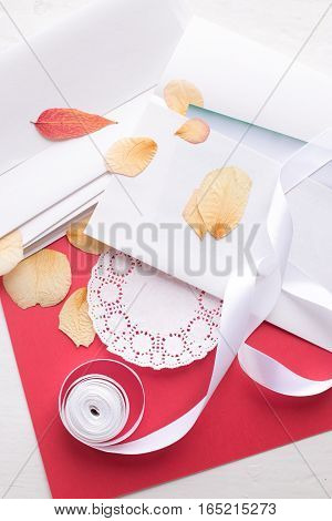 St. Valentine's Day: the dried petals of roses and paper envelopes, are ready to packing of the love letter