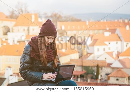 Beautiful young woman working on the computer.