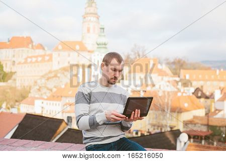 Adult male works on the computer. freelancer
