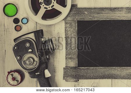 Old movie camera and accessories are painted on a white board.View from above.
