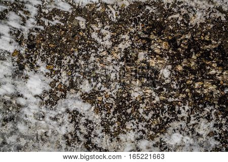 Asphalt, asphalt covered with ice and snow, asphalt texture