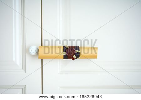 Scroll to the wedding invitation with ribbon and stamp on the white background