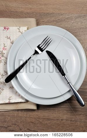 Dining etiquette - I still eat pause. Fork and knife signals with location of cutlery set