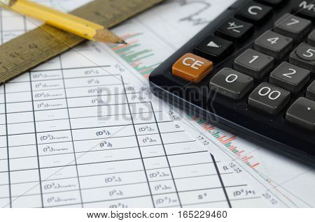 On the stock count and graphics are pencil, wooden ruler and a microcomputer