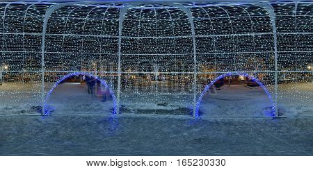 TÂRGU MUREȘ, ROMANIA - December 29, 2016: 360 panorama inside a giant Christmas ornament in winter nighttime in a snow-covered Piața Trandafirilor, town centre of Târgu Mureș, Romania