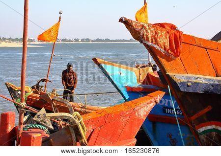 DIU, INDIA - JANUARY 7, 2014: Colorful fishing boats in a fishing port in Diu Island