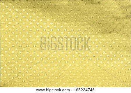 Gold foil paper with stars decor pattern background for artwork.