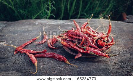 Dried red pepper on brown wood, dried chilli.