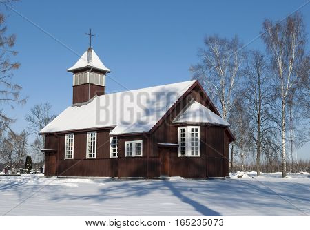 The wooden village church in Winter time (Lithuania).