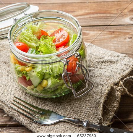 Photo of morning vegetarian salad on served table