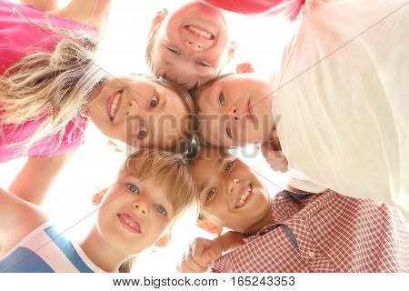 Happy childrens standing in the circle, close up