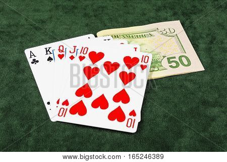 On the green baize lie flush and banknote