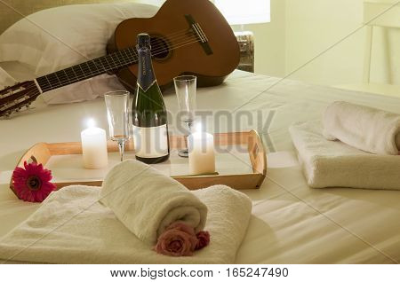 romance in bed with champagne and guitar, interior