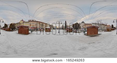 TÂRGU MUREȘ, ROMANIA - December 29, 2016: 360 panorama of decorated wooden booths in winter daytime in a snow-covered Piața Trandafirilor (Roses' Square), town centre of Târgu Mureș, Romania
