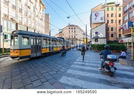 MILAN ITALY - September 06 2016: The start of traffic jam with tram cars and scooters on the Torino street (Via Torino) in the city center in Milan.